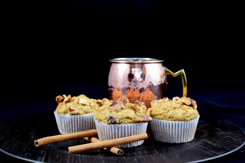 harvest oat muffins with cinnamon next to a copper mule mug