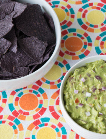 blue tortilla chips and guacamole