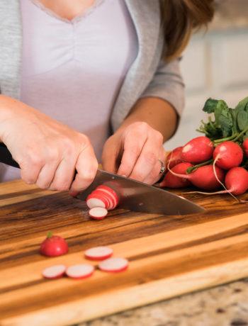 radishes on cutting board