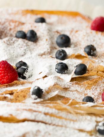 garnishing very berry phyllo bars with berries