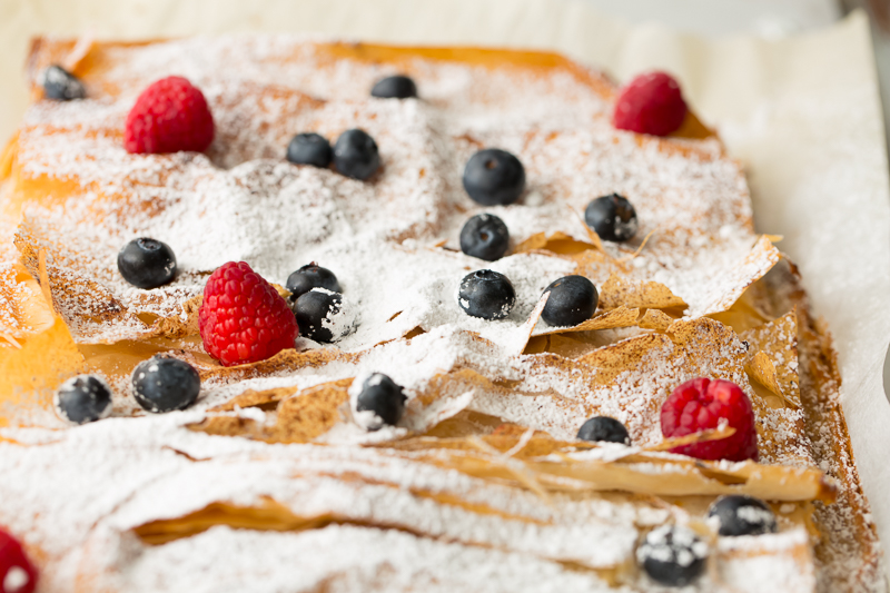 garnishing very berry phyllo bars with berries