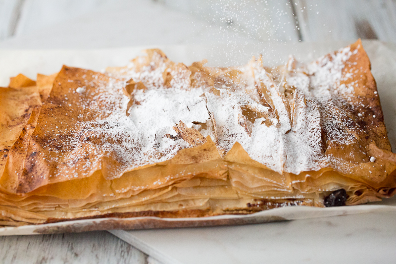 dusting very berry phyllo bars with powdered sugar