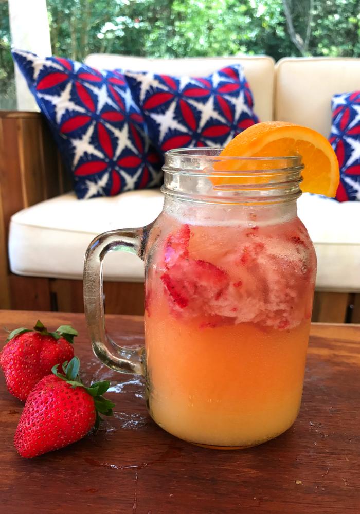 strawberry orange fizz in a mason jar
