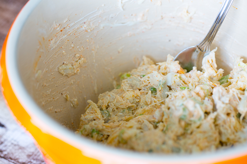 raw warm crab dip in mixing bowl