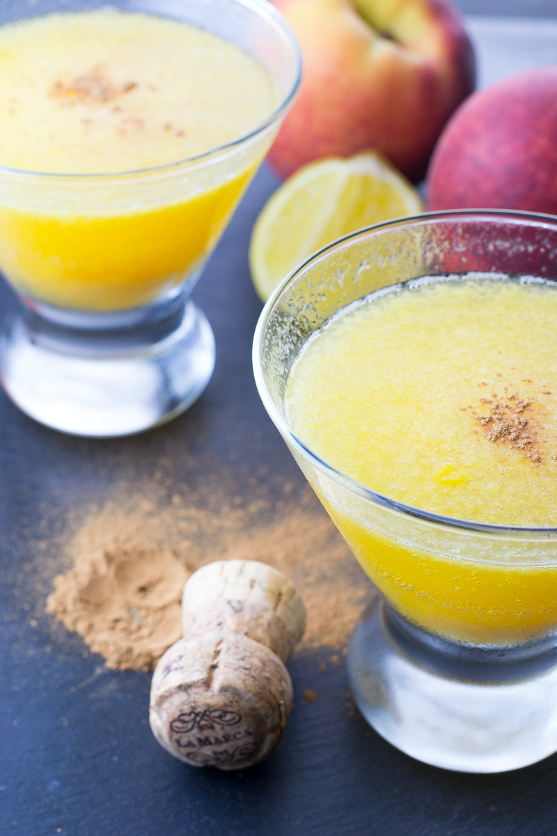 peach bellini mocktail with cinnamon in a glass