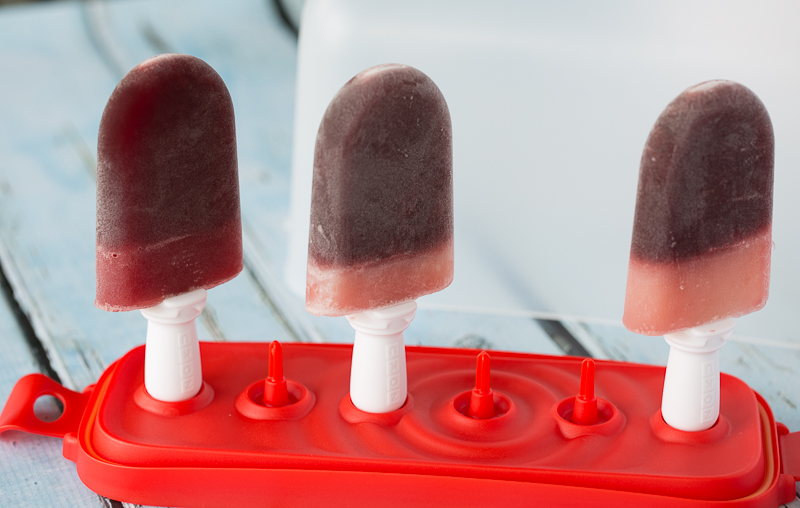 three popsicles in zoku popsicle storage container