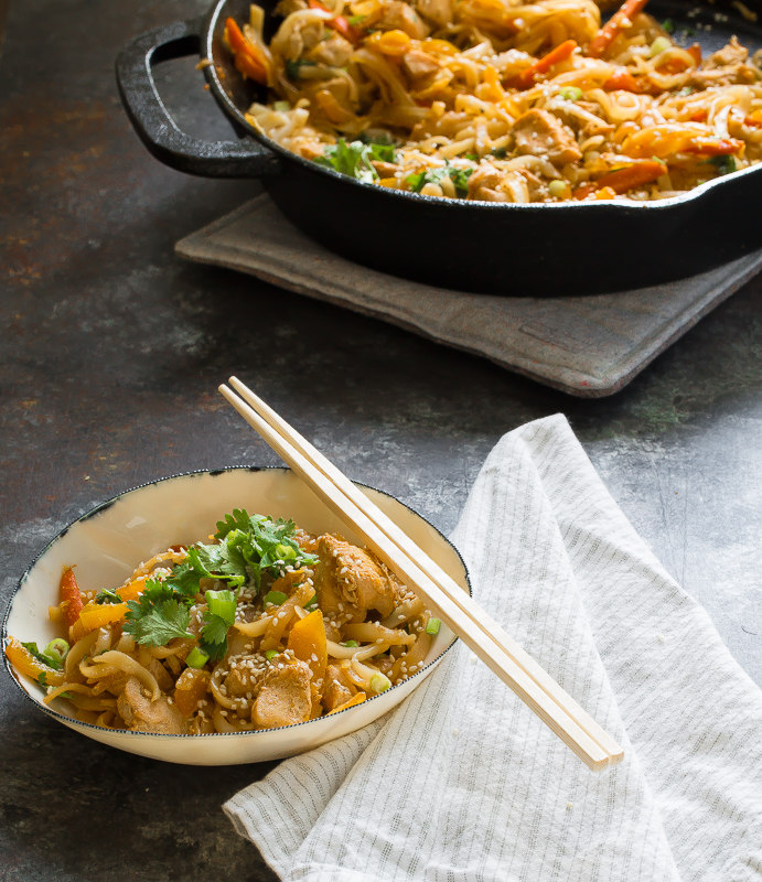 pad thai in bowl with chopsticks