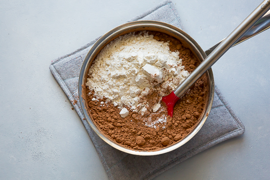 flour and cocoa to make brownie batter