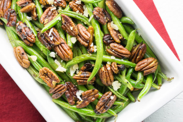 sautéed green beans with curried pecans #greenbeans #thanksgivingrecipes deliciouslyplated.com