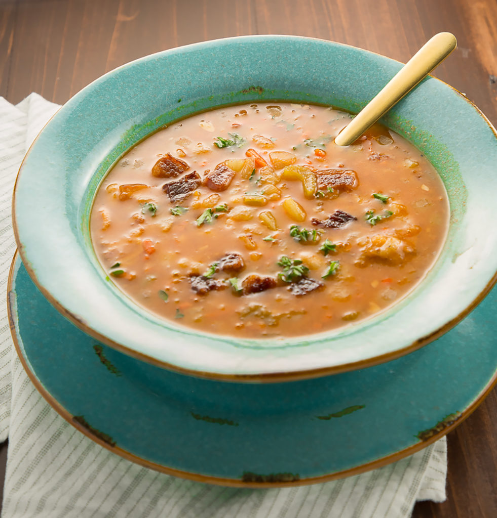Bean and Bacon soup in a teal bowl