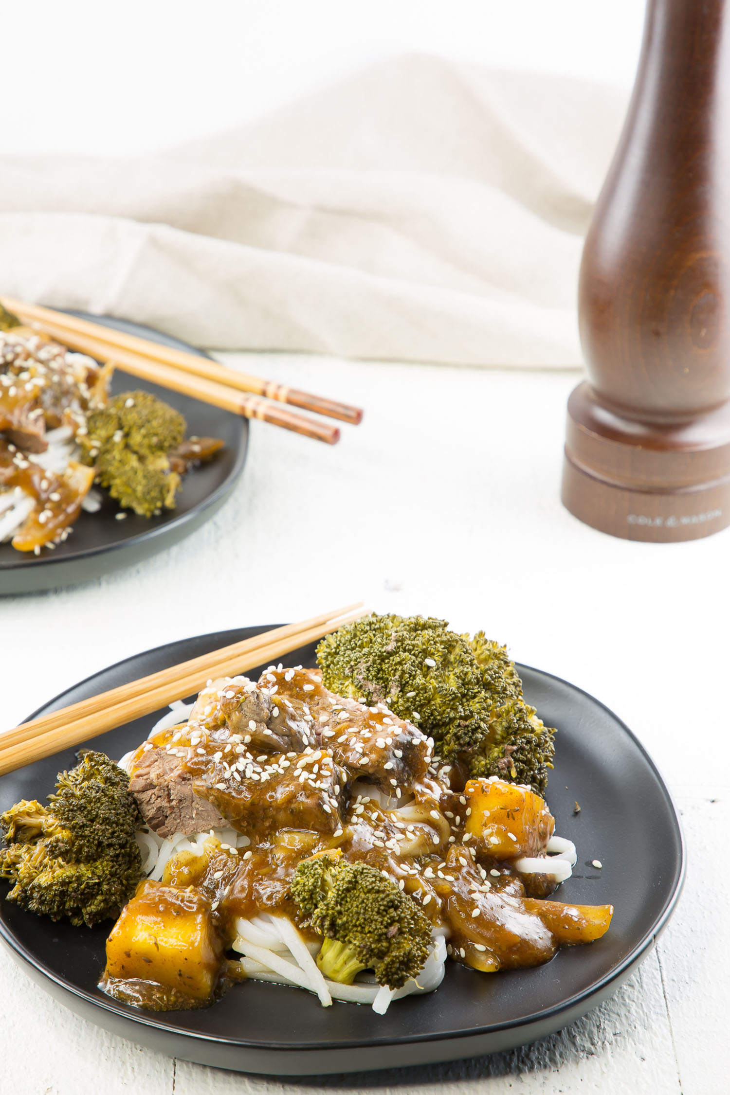 beef and broccoli bowl with chopsticks
