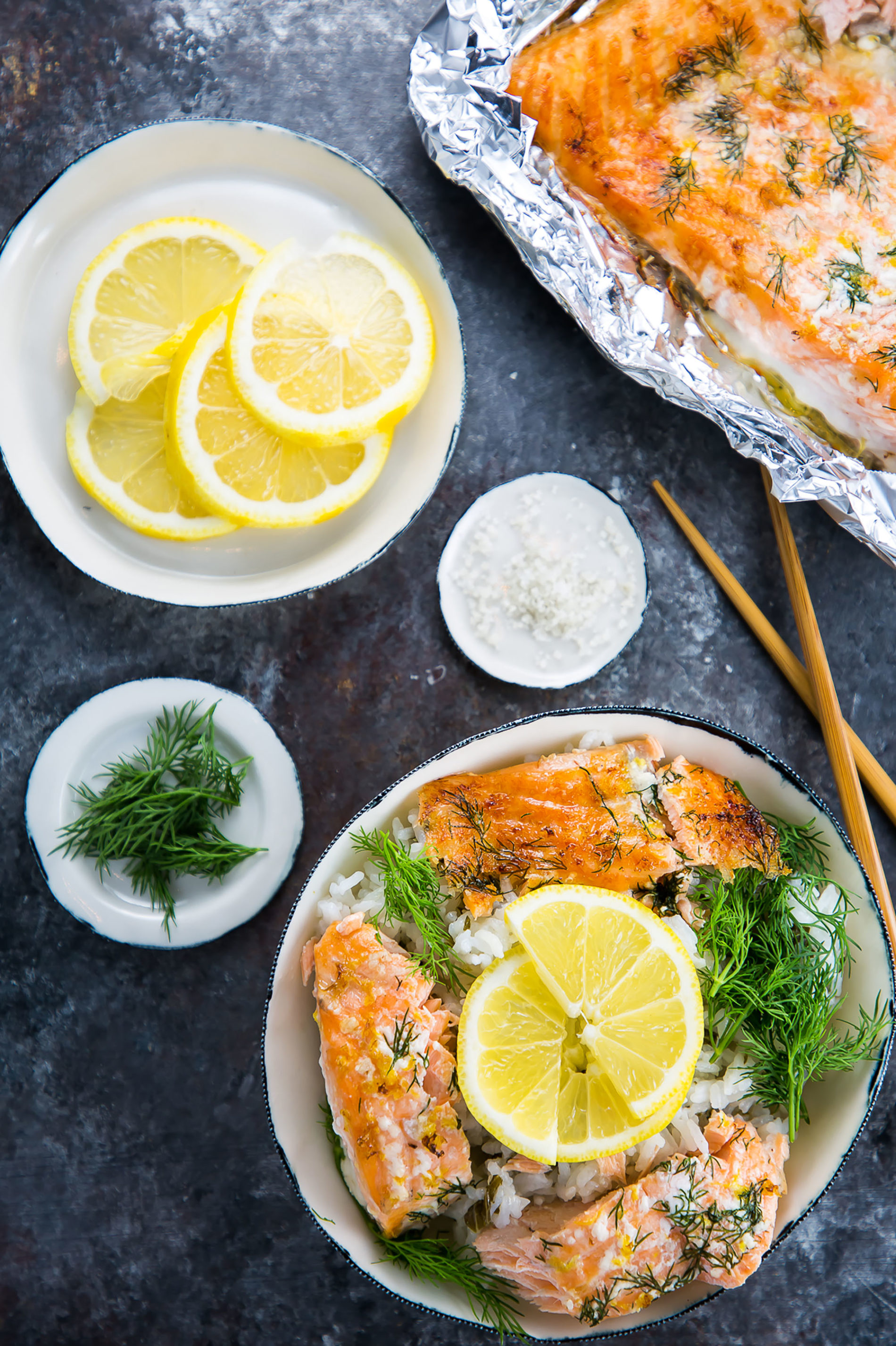 baked salmon in a rice bowl with lemon and dill