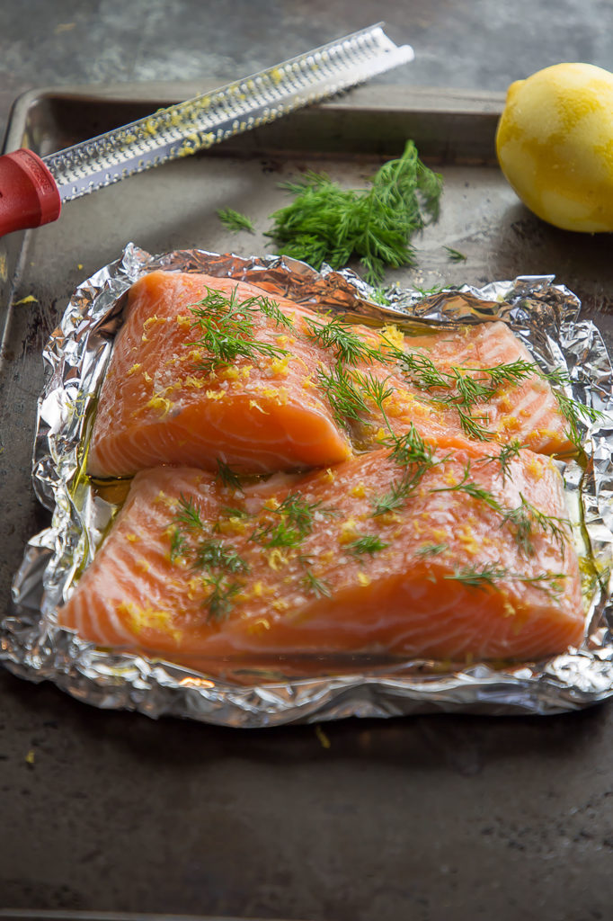 raw alaska king salmon fillets with lemon and dill