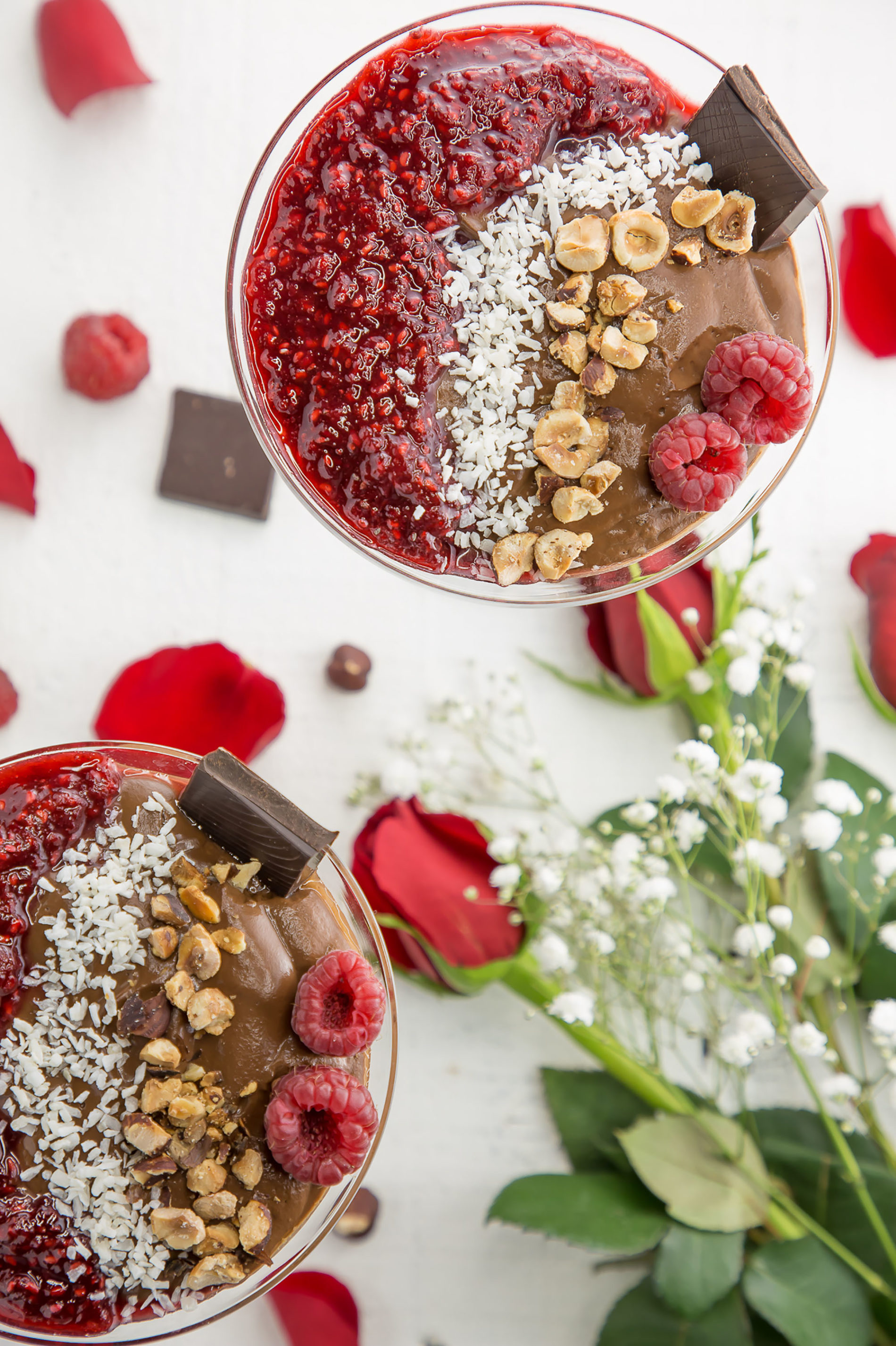 vegan chocolate pudding in a martini glass with rose petals and chocolate
