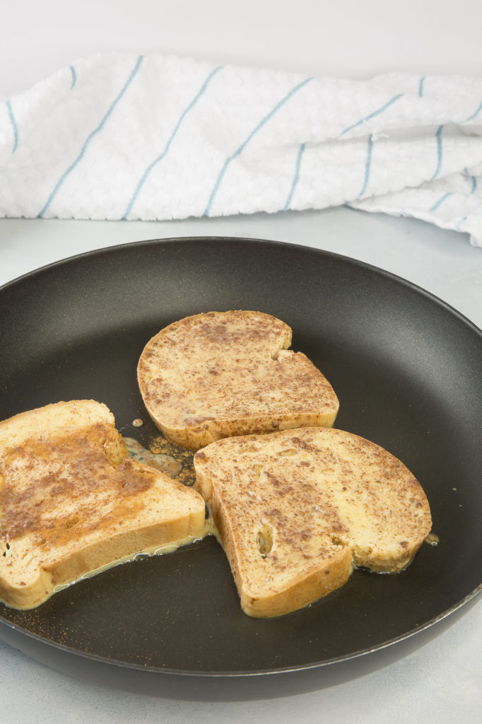 french toast pieces cooking in a pan