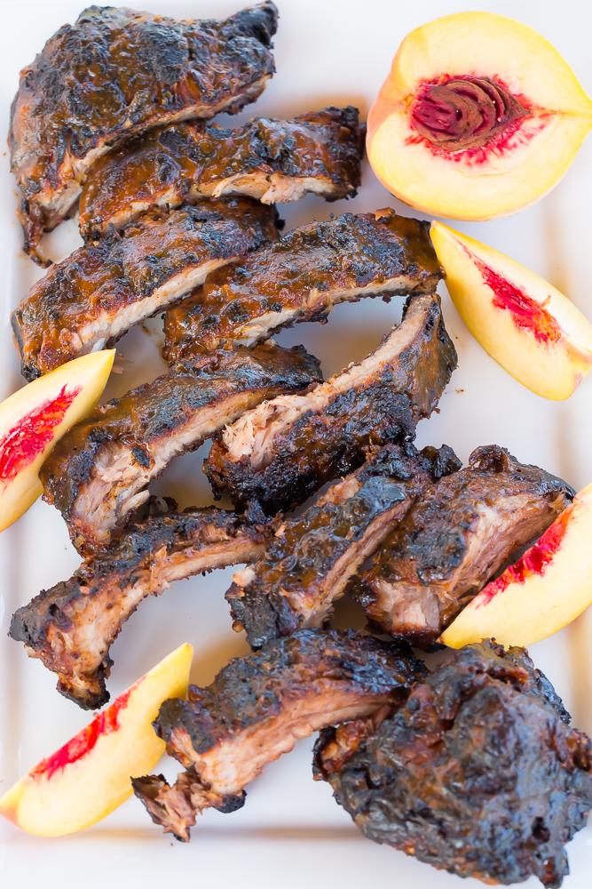 Bourbon peach grilled ribs on a platter