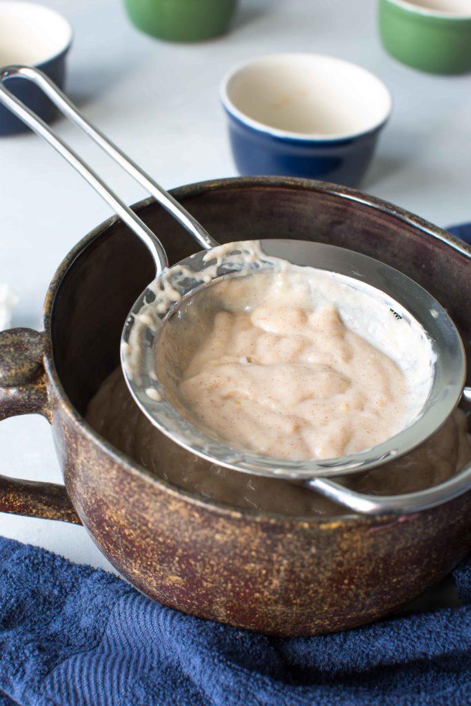 straining honey and cinnamon pudding with caramelized bananas